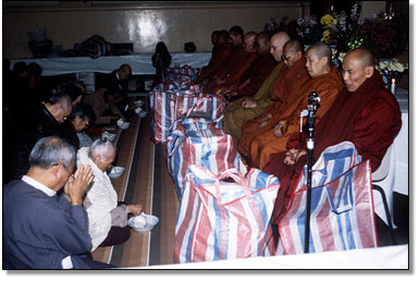 The Sangha accepting Dana