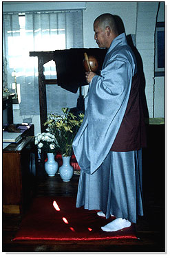 Monk conducting a service.